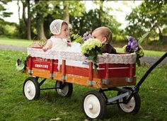 Are your little ones too little to make it down the aisle? Try having an older sibling or relative pull them in a decorated wagon! So precious!