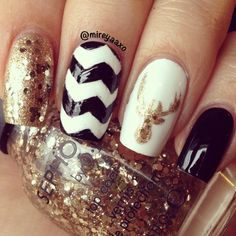 Reindeer and Chevron design Christmas nail art in monochrome and shimmering gold...x