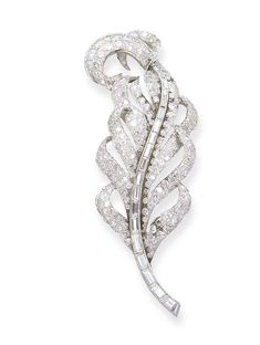 A DIAMOND FEATHER BROOCH   Designed as a pavé-set diamond openwork feather with baguette-cut diamond stem, 9.5 cm long