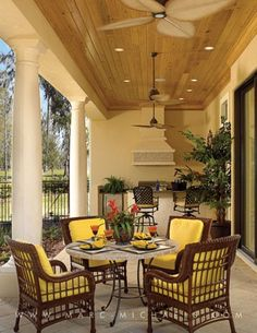 Wonderful Southern Porch with a high ceiling and wicker furniture, Ecclestone Signature Homes, Marc-Michaels Interior Design, Inc.
