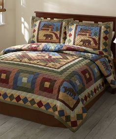 Fall hues and a woodland motif lend an eye-catching touch to this quilt. Its cotton face enhances cozy softness.