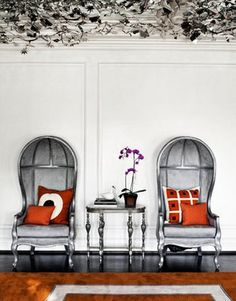 silver bergere chairs and orange