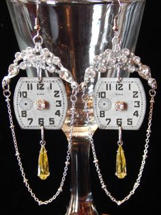 A personal favorite from my Etsy shop https://www.etsy.com/listing/267811180/vintage-watch-face-earrings-with