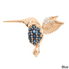 This charming brooch pin features a 10-karat gold hummingbird studded with sparkling sapphires or rubies, accented with seven 0.03 carat diamonds for the eye and along the wings. This beautiful brooch