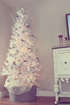 White Christmas Tree in a galvanized bucket!!! Bebe'!!! Decorated with White Glass Ornaments and Tiny White Birds!!!