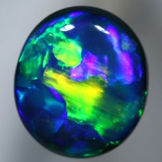 SOLID SEMI BLACK OPAL Absolute top quality, Flagstone Harlequin with the brightest rolling flashes. WITH VIDEO   AussieTreasureChest.com.au