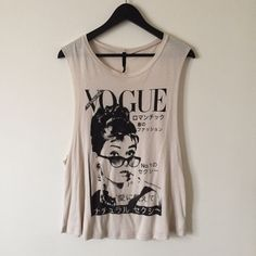 Audrey Hepburn Vintage Vogue Tee Audrey Hepburn on the cover of Vogue on this sleeveless tee, can fit a small/medium and was never worn! (Not UO, listed for style) Urban Outfitters Tops Tank Tops