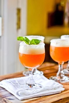 ... bottle 2-3 cups ice Raspberries and 4 springs mint, optional garnish