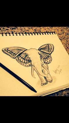 Elephant butterfly ears tattoo meaning