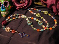 Dia de los Muertos-- how cool I have been wanting to make my own rosary...