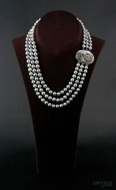 Lady of the Lake Grey - These luminous grey pearls cultured from the South China Sea share a distinctive set of attributes – class, beauty, and originality. Designed for a more sophisticated woman, this elegant piece is sure to transcend some of it attributes to the wearer.