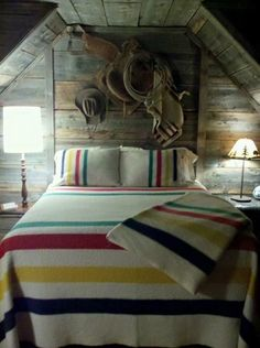 Good night from the man cave bedroom! Who loves this Western themed cabin decor?
