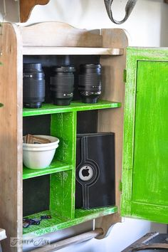 Bright green and black cabinet for camera lens and iPad storage - part of a funky wall cabinet gallery reveal via : http://www.funkyjunkinte...