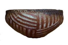 Prehistoric Egyptian small coiled bowl about five inches diameter. The decoration appears to mimic a basket.