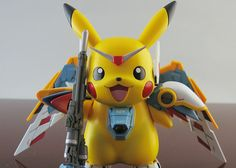 Pikachu Gundam Wing-- I don't know what I'd do with it, but I feel like owning it might make my life better. Desk pet-- that's what I'd do with it. Pikachu Pikachu, O Pokemon, Gundam Wing, Gundam Art, Anime Figures, Action Figures, Science Fiction, Geek News, Anime Nerd
