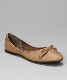 Fashion, fit and functionality: the three F's expected from flats. Detailed with timeless tassels, these polished steppers will keep feet looking ladylike and sophisticated.