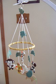 """Baby Mobile - Baby Crib Mobile - Jungle  Mobile - Nursery Baby Room """"Jungle Lullaby"""" (You can pick your colors). $60.00, via Etsy."""