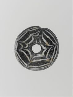 Glass spindle whorl  Period: Early to Mid Imperial Date: ca. 1st–2nd century A.D. Culture: Roman Medium: Glass Dimensions: Overall: 3/8 x 7/8in. (1 x 2.2cm)
