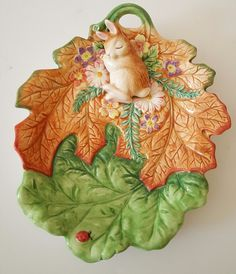 http://www.ebay.com/itm/Fitz-and-Floyd-Classics-Bunny-Rabbit-Sleeping-on-Leaves-Lady-Bug-Plate-Easter-/111922802830?hash=item1a0f1e708e