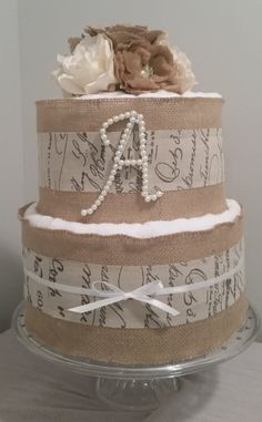 3 or 2 tier Burlap towel cake!A touch of rustic elegance.  Wedding gift or bridal shower centerpiece. Includes mini burlap bouquet by MyJoyfulTiers on Etsy
