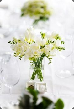 Great example of a simple and sweet smelling arrangement of white Freesia.