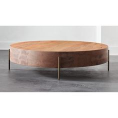 Shop Proctor Low Round Wood Coffee Table.  A play on contrast and proportion, super thick solid acacia wood top sits low to floor on skinny antique bronze legs.  Oversized round surfaces natural grains, knots and fissures that add to the unique beauty of each coffee table. Round Wood Coffee Table, Round Coffee Table, Living Furniture, Home Furniture, Wood Stumps, Pick Up Trash, Acacia Wood, End Tables, Knots