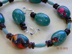Turquoisecolorful fabric covered beads and by SantaFeCollection