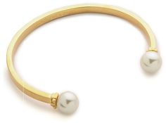 Tory Burch pearl bangle at ShopBop. I'm not generally a Tory Burch fan, but I do love this. Great price.