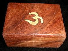 Small Wooden box with brass inlaid Ohm design