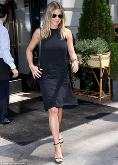 Amazing figure: Two weeks ago, the Mother's Day star displayed her toned legs in a black dress with matching strappy heels and purse in New York City