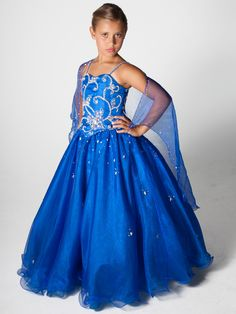 This long pageant dress by Unique Fashion Pageant Gown UF1053F has a modified sweetheart neckline, beaded spaghetti straps and a beautiful floral beaded and embroidery on the bodice. Completing this look is a full A-line skirt with beading. Wear this cute dress and you will look like a princess for your pageant.