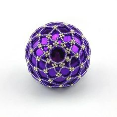 Shiny Purple bauble with silver web. (colour number: 144-115) Our baubles are made from real glass, and will add an elegant air to your tree or decorations. The beads give them a hint of antique or vintage. The baubles are versatile; They look really pretty hanging on the tree, or