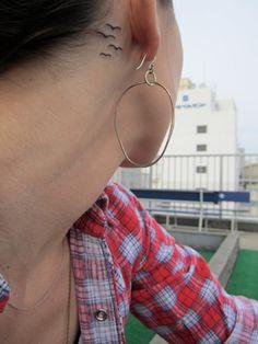 Sara barielles' tattoo behind her ear <3