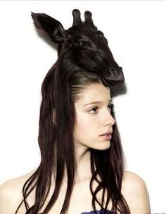Put a giraffe on your head. Maybe she'll start a new trend!