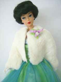 Finally found one of the original Barbies.Mine was like this one with black short hair.There aren't too many like this on any of the Pin pages.I wonder why