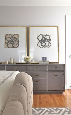 Fabulous bedroom featuring abstract art by Rosa Beltran on gray walls, Benjamin Moore Shoreline, in gold leaf gallery frames on gray campaign dresser painted Benjamin Moore Eagle Rock. Gold Wall, Campaign Dresser, Campaign Furniture, Interior Decorating, Interior Design, Neutral Decorating, Screen Design, Benjamin Moore Gray, Benjamin Moore Shoreline
