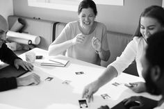 Grayscale Photography of Four Person Having A Discussion  Free Stock Photo