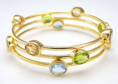Gold plated stackable bezel bangles with semi precious by Voneshna, $129.00