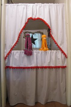 Use old curtains to make puppet theater