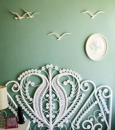 Bed head inspiration. Love the birds and the pale green and white combo. Gorgeous wicker headboard.