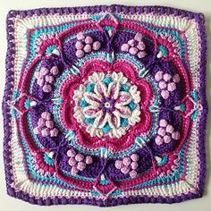 A large super-textured, decorative floral block . From BoHo to Classic Neutrals, this block looks gorgeous in any colouway! This square was designed with a finished product in mind. Meaning, once you have completed the square you will have a ready-sized cushion cover frontispiece. But don't stop there. Join nine squares to make a striking lapghan and twelve squares…well, you'll have a blanket! This large piece is designed to be easily upsized or downsized by changing your hook size and/o...