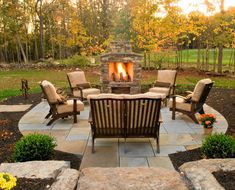 Stone fire place, cushioned seating, slate/stone under foot. I like it. Indeed.