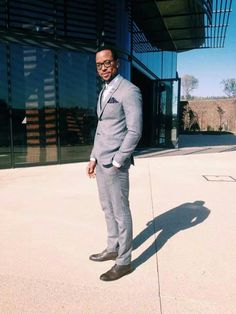 Maps maponyane well dressed man in a suit