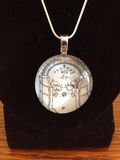 Handmade glass pendant necklace with picture of the door to Moria from the Lord of the Rings