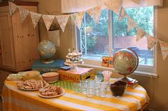 Maps & globes for a 1st bday?! Totally worked! Could use some of the ideas for the end of the year school party. We have been traveling around the world! :)