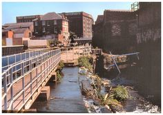 The Nottingham Canal and River Leen - July 1989 . In times of yore a river flowed close by Nottingham Castle. However the Victorans devised a way to have the water diverted and put out of sight.Their actions aided a canal construction, road building