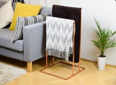 Blanket storage doesn't have to be an afterthought. From a repurposed drying rack to a DIY ladder, here are several attractive storage solutions for blankets. Blanket Holder, Blanket Rack, Blanket Storage, Diy Throw Blankets, Living Room Storage, Sofa Tables, Fall Home Decor, New Room, Wedding Decor