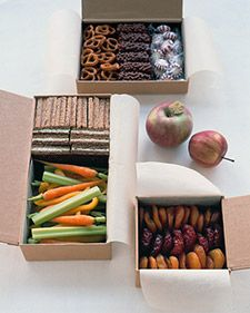 """""""Wedding days can be long, especially for the attendants who are with the bride every step of the way. Having some snacks close by will ensure that the bridal party has enough energy to make it to the last dance. Line flip-top kraft-paper boxes with natural parchment, and fill them with finger foods such as pretzels, crudites, small sandwiches, and dried fruits."""""""