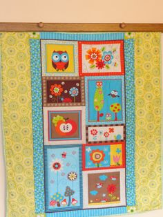 OWLS, flowers and  frogs Baby Quilt for boys or girls.  Gorgeous bright colors, Orange, turquoise, green and brown via Etsy