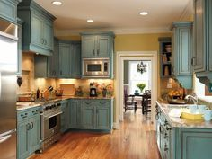 Turquoise rustic cabinets. This is perfect for my kitchen!!